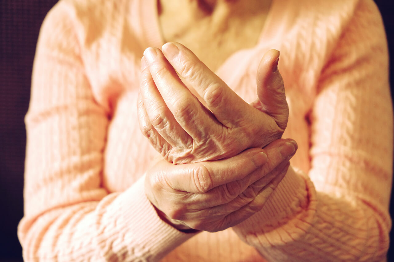 Close up of mature womans hands. Health care giving, nursing home. Parental love of grandmother. Old age related diseases.
