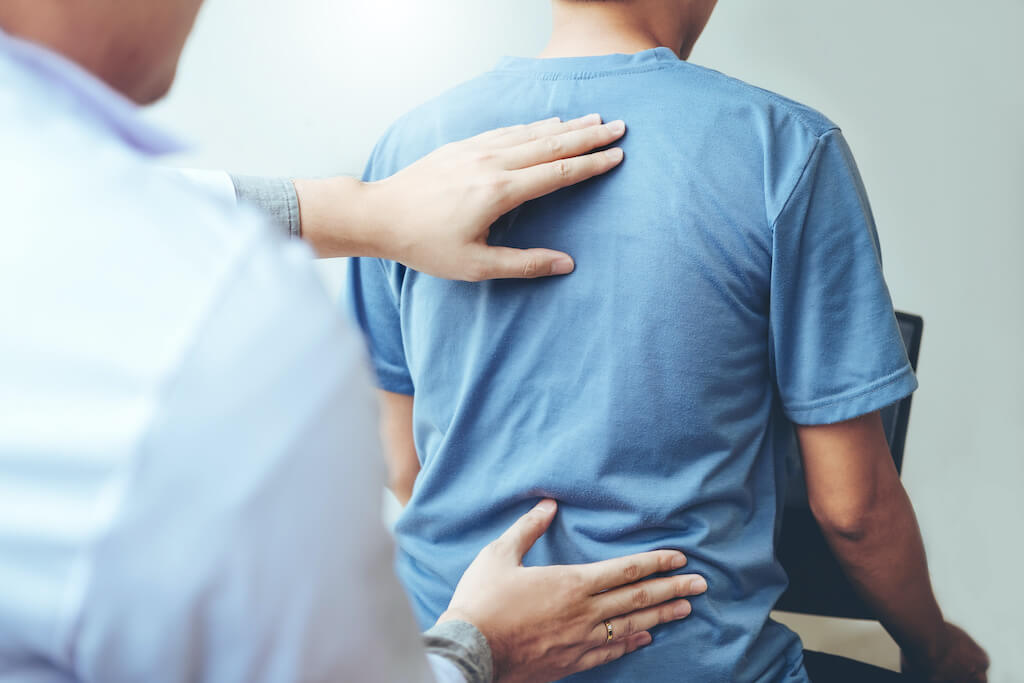 Back problems Physical therapy concept